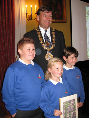 Pupils from Sarum St Pauls Primary School receive their Gold award